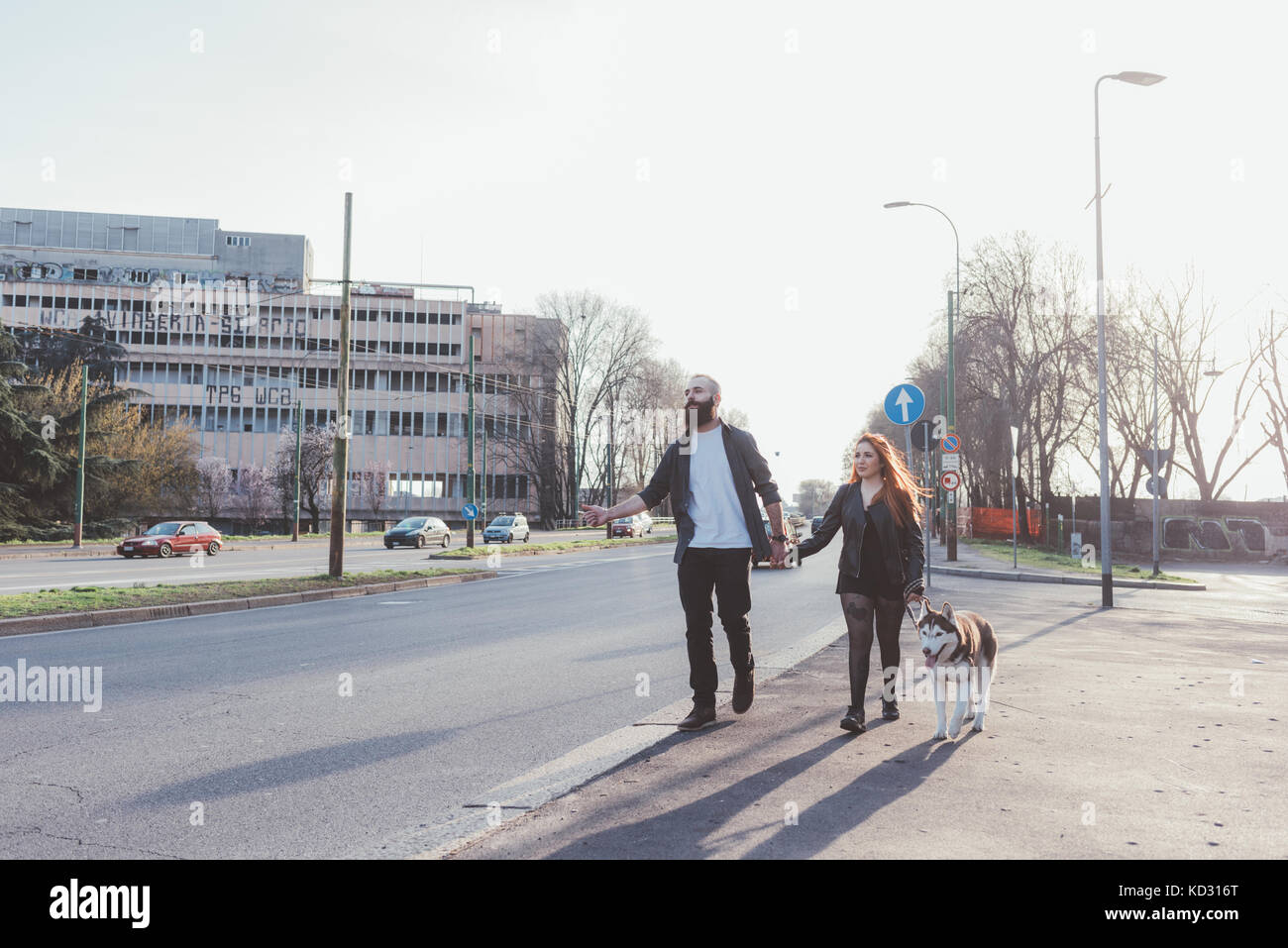 Couple walking with dog - Stock Image