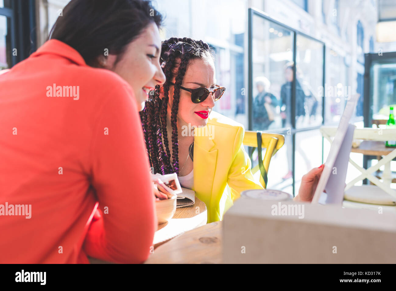 Women on city break at outdoor cafe, Milan, Italy Stock Photo