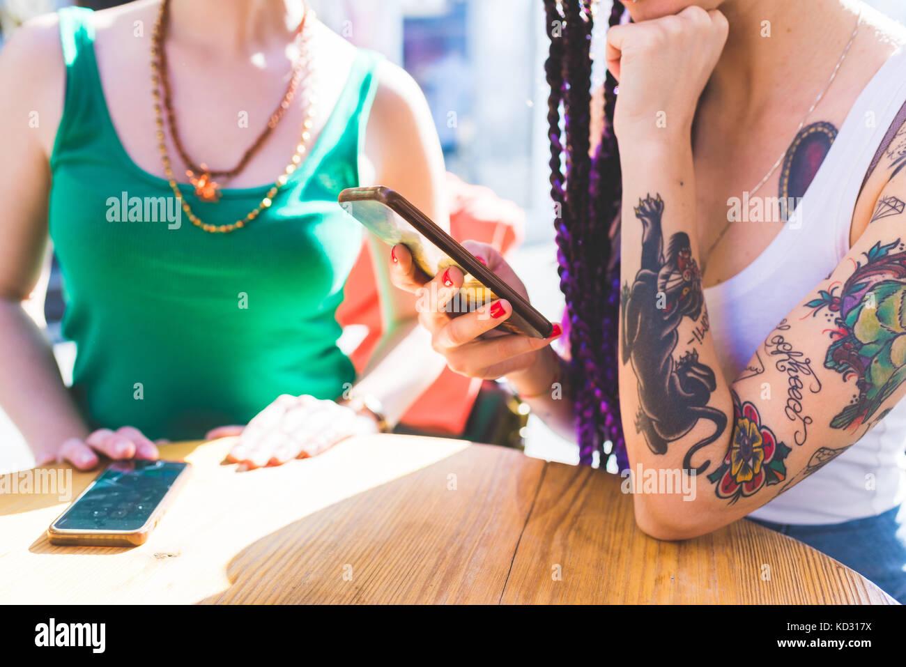 Women on city break at outdoor cafe, Milan, Italy - Stock Image