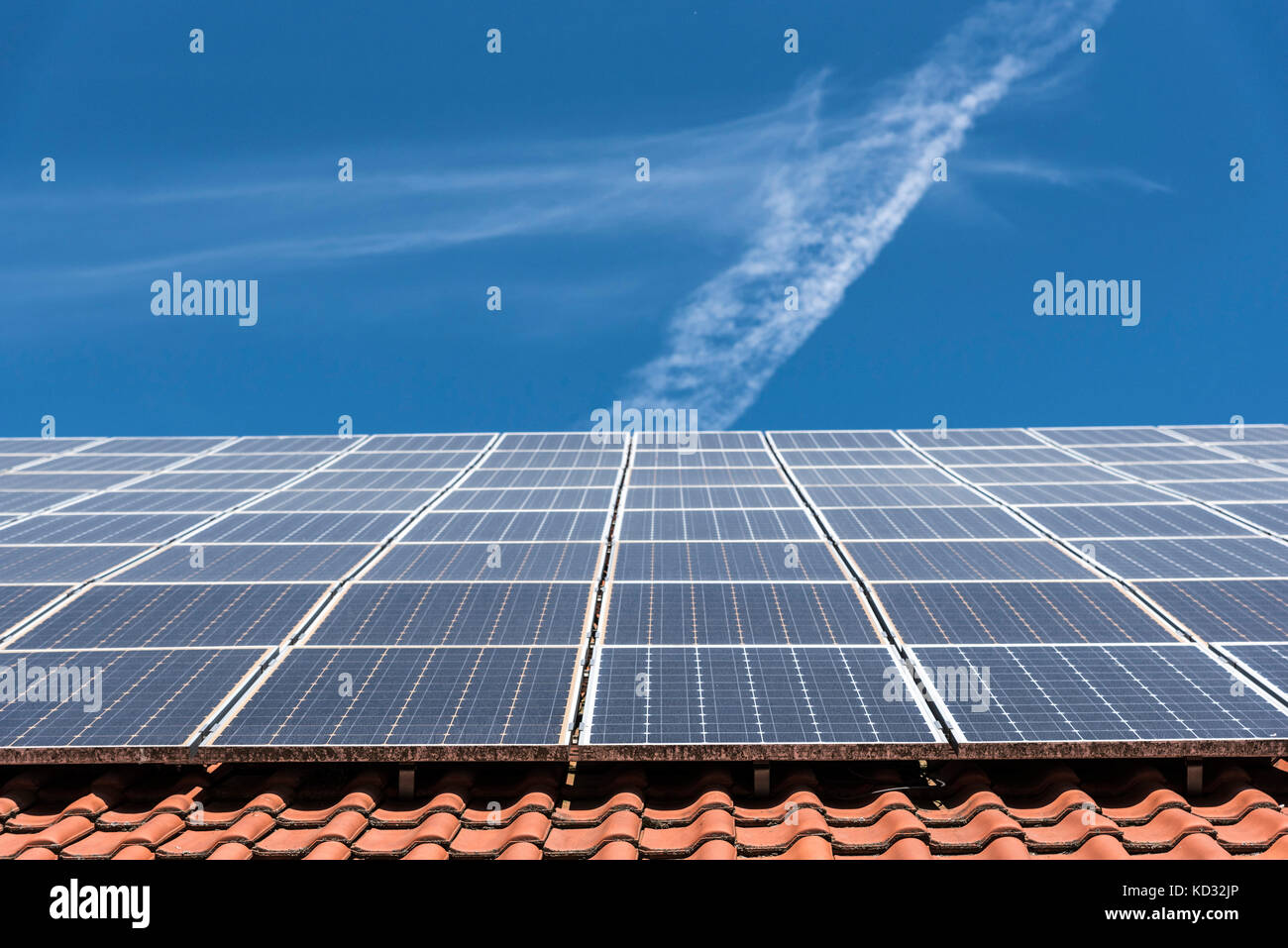 Solar panels on roof, low angle view, Munich, Germany - Stock Image