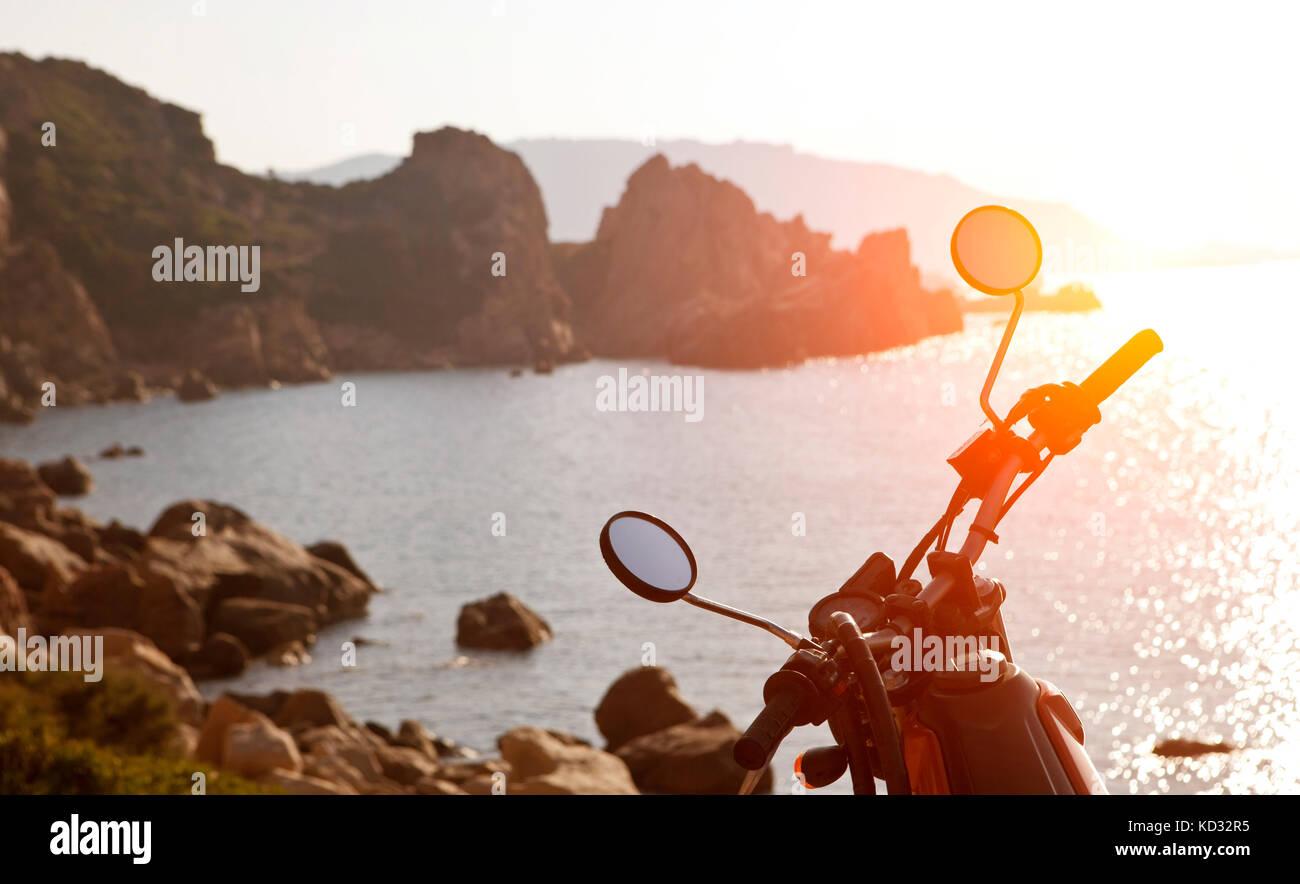 Motorbike by sea at sunset, Olbia, Sardinia, Italy - Stock Image