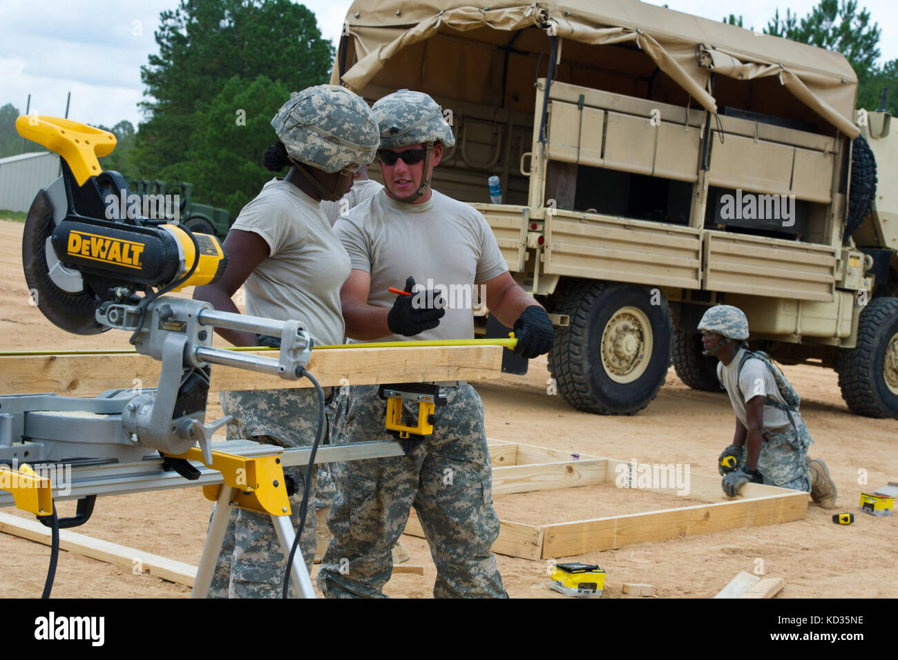 U.S. Army engineers assigned to the 1223rd Engineer Company (vertical) from Jedburg, S.C., build a demo house during - Stock Image
