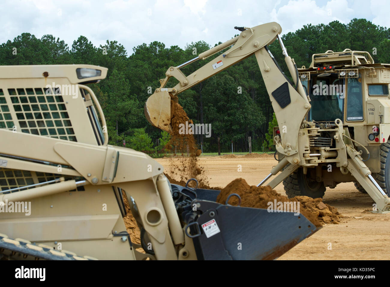 U.S. Army Soldiers assigned to the 124st Engineer Company (horizontal) from Saluda, S.C., dig a culvert a during - Stock Image