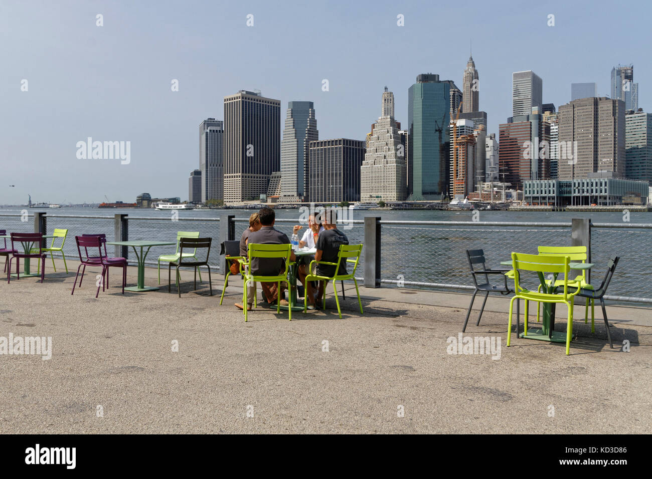 NEW YORK CITY, USA, September 11, 2017 : View of Manhattan skyline from the Brooklyn park. Brooklyn Bridge connects - Stock Image