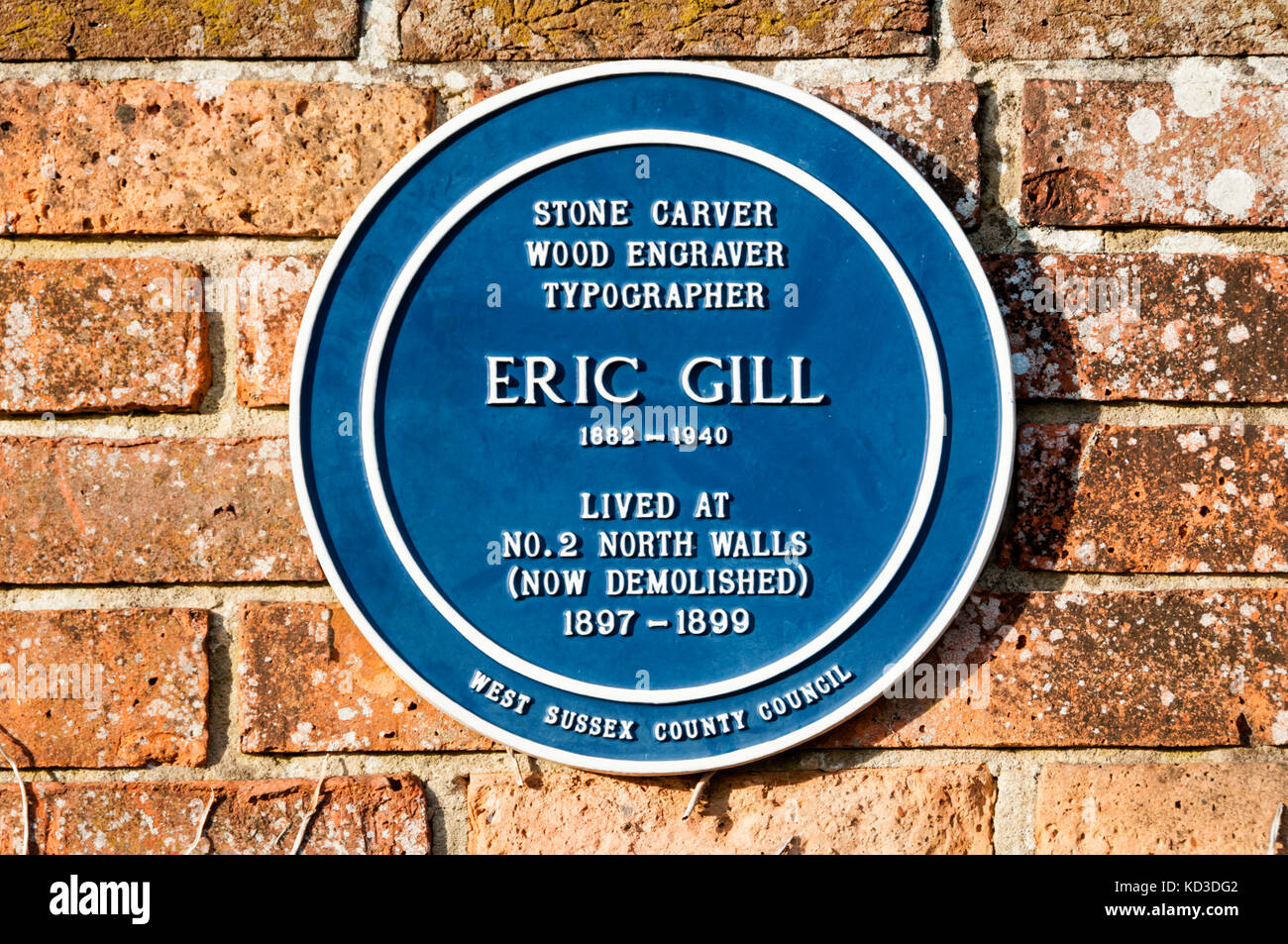 A blue plaque commemorating the stone carver, wood engraver & typographer Eric Gill in Chichester - Stock Image