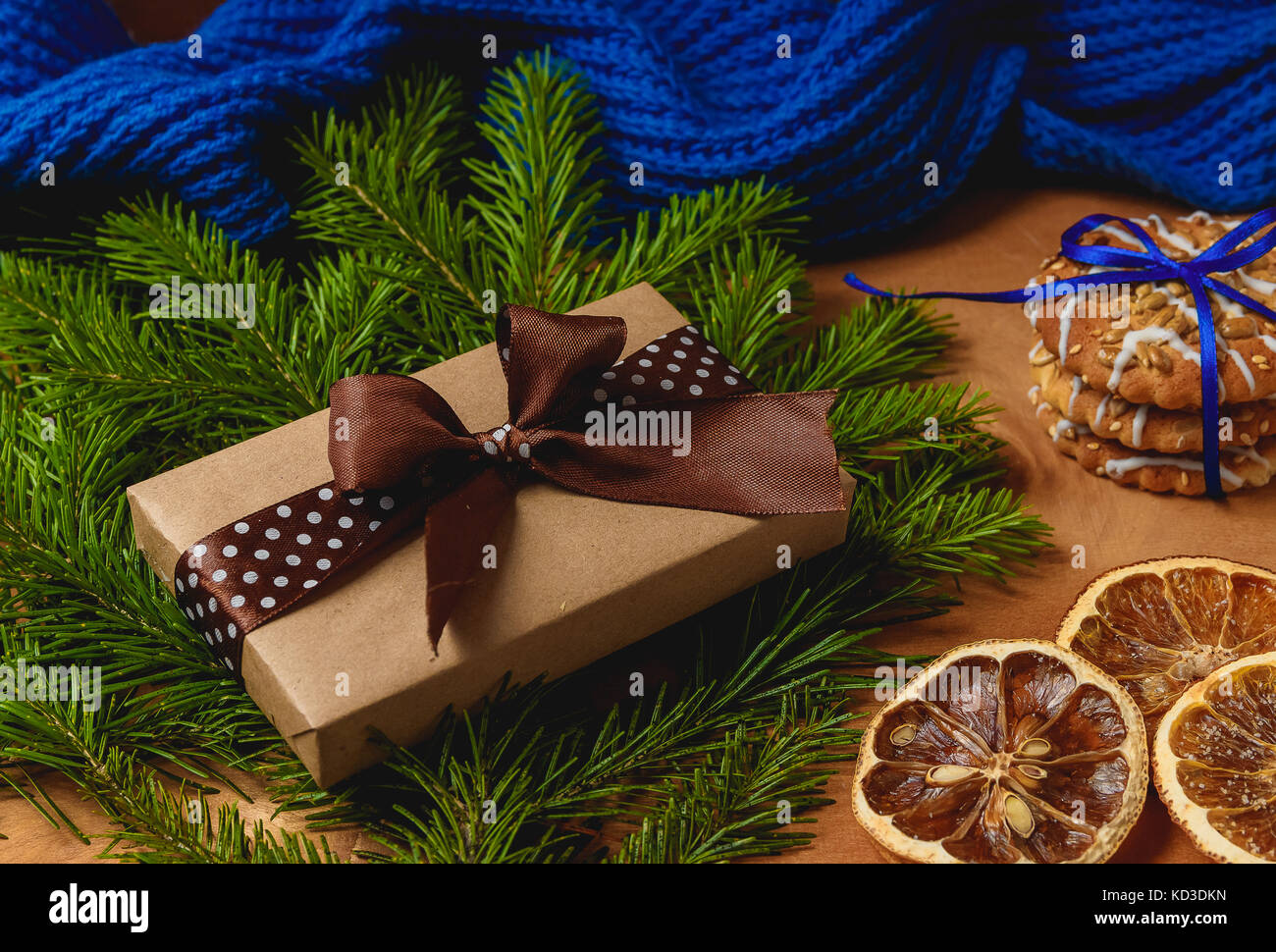Christmas gift or present box wrapped in kraft paper on christmas decoration Stock Photo