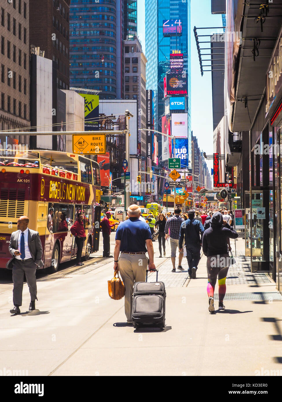 New yorkers and tourists going to Time Square, Manhattan Stock Photo