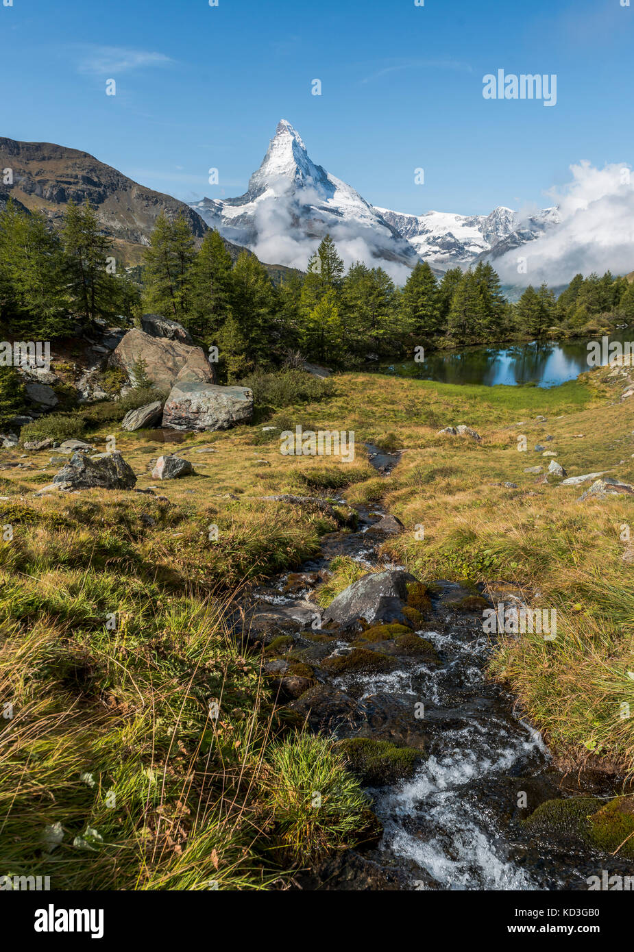 Snow-covered Matterhorn, stream flows into the Grindijsee, Valais, Switzerland - Stock Image