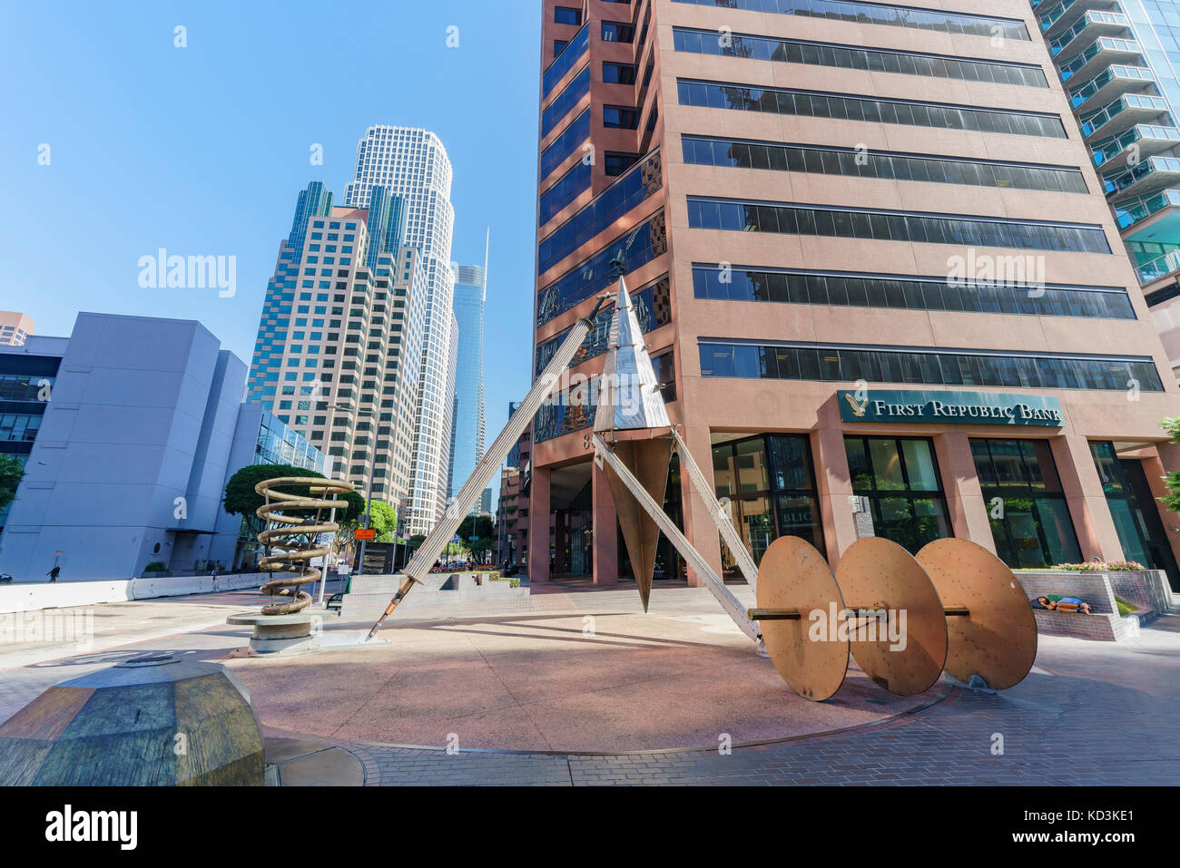 Morning view of art object and downtown skyscrappers - Stock Image