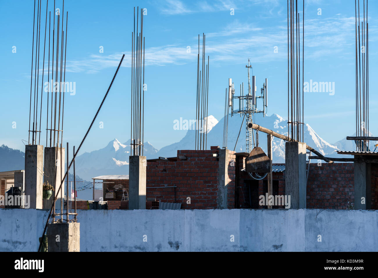 Construction site and Huascaran mountain in the background, Huaraz city, Peru Stock Photo