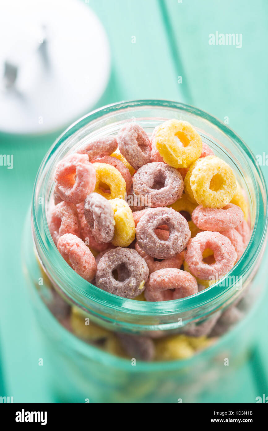 Colorful cereal rings in jar. - Stock Image