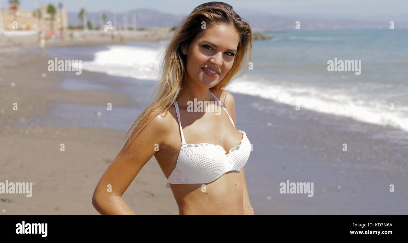 Model in swimsuit posing on beach Stock Photo