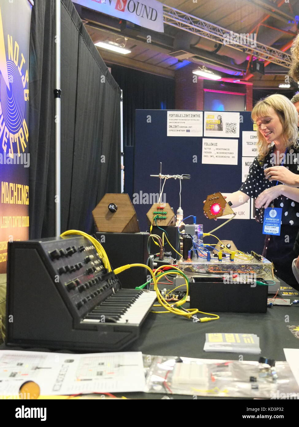 Vicky Clarke of Noise Orchestra demonstrating devices which turn light into sound at Synthfest UK, The Octagon Centre, - Stock Image