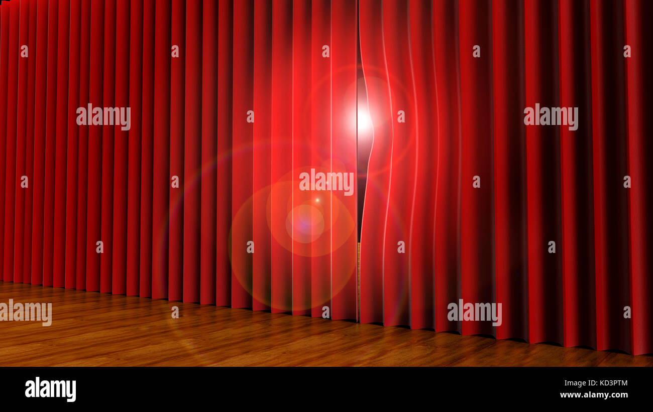 light peeping through theatre curtains on stage. - Stock Image
