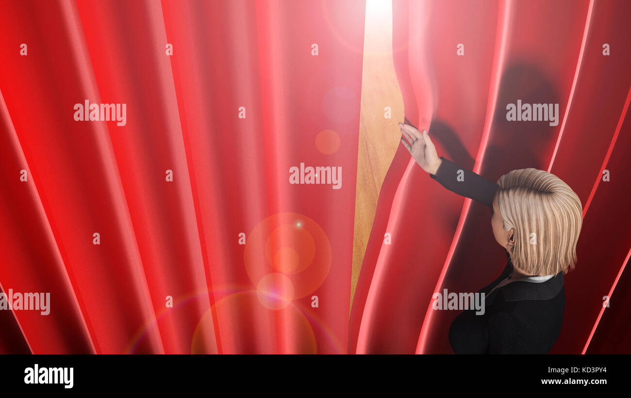 woman looking through theatre curtains on stage. - Stock Image