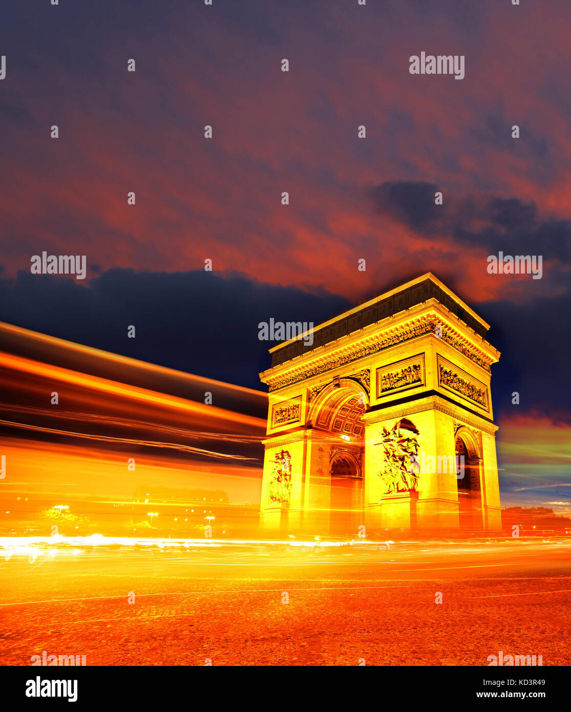 Famous Arc de Triomphe at night in Paris, France - Stock Image