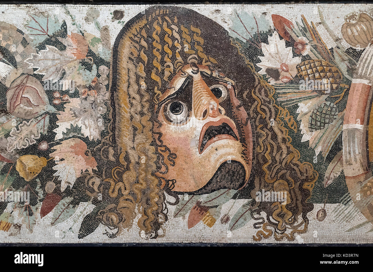 Naples. Italy. Roman mosaic (2nd century B.C.) with theatrical mask and festoon with leaves and fruit (detail), - Stock Image