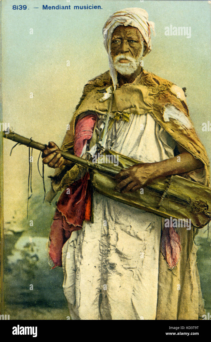 Moroccan musician  holding a gunibri (sintir/hajhuj), a three string lute with semi-spiked construction, skin covered - Stock Image