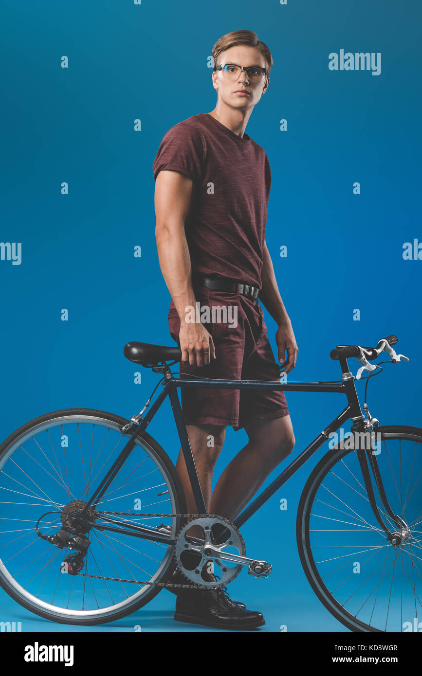 young man with vintage bicycle - Stock Image