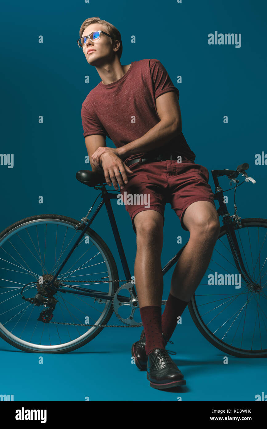 young man with vintage bicycle Stock Photo