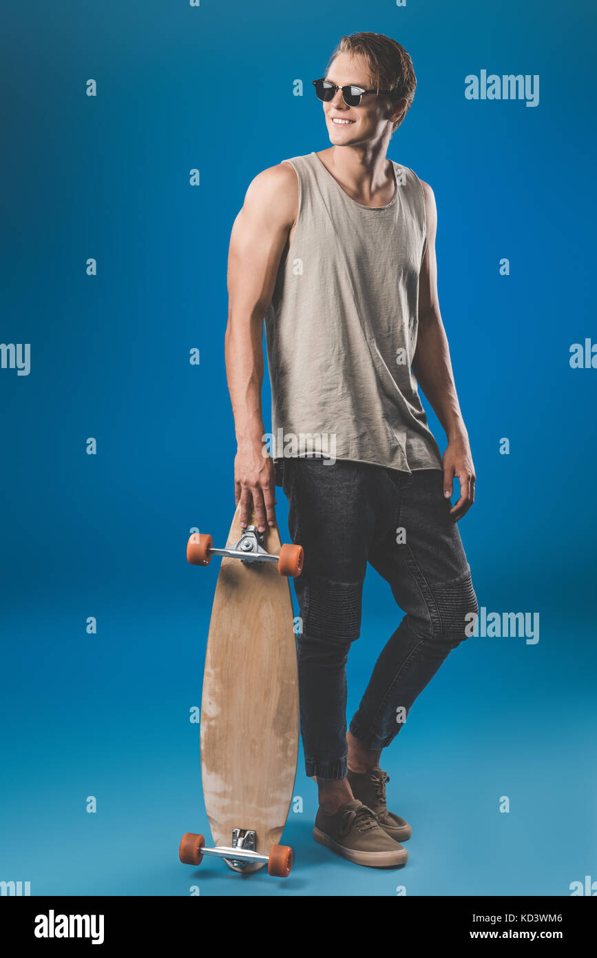 young man with skateboard - Stock Image