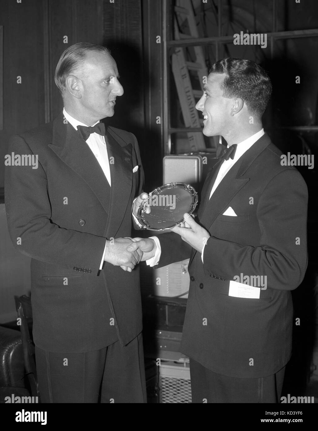 Brian Taylor (r), 24-year-old Essex batsman and wicketkeeper, receives the Young Cricketer of the Year trophy from - Stock Image