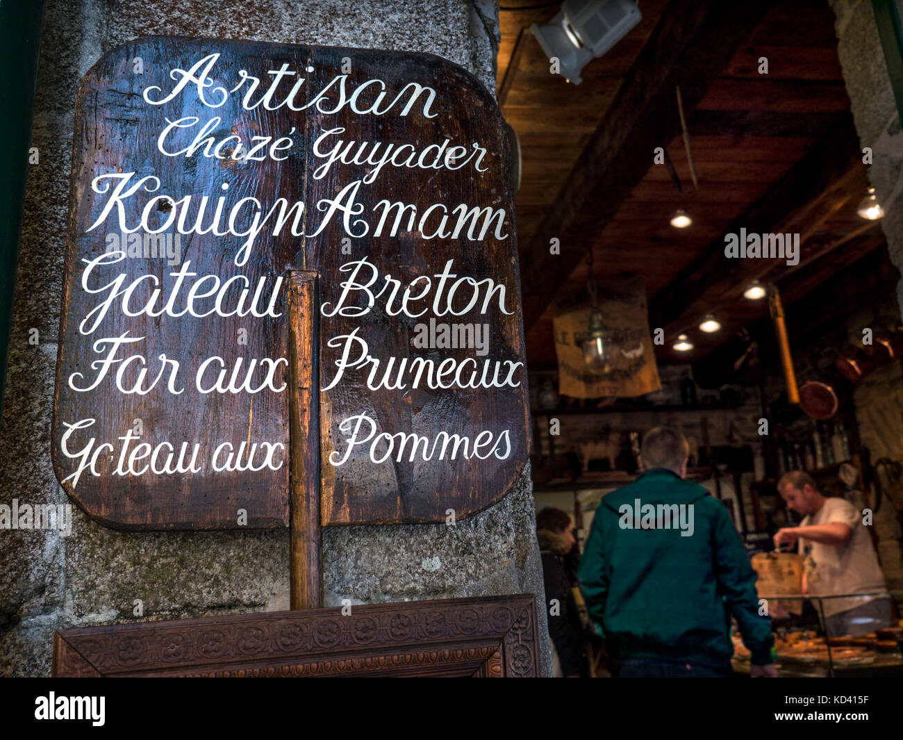 Artisan baker, rustic wooden sign made from old bakers shovel and interior of Chazè Guyader  Old Town Concarneau - Stock Image