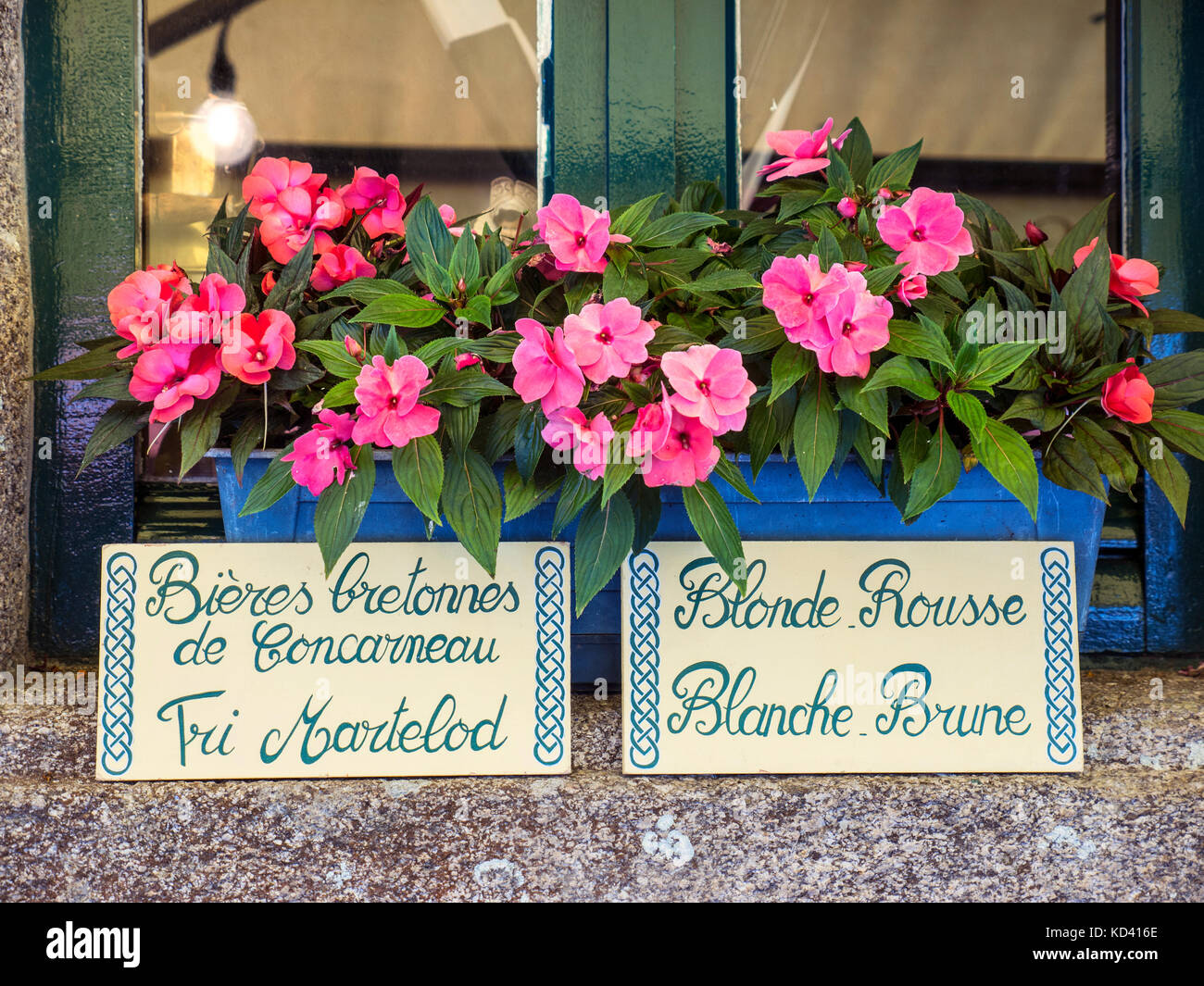 Floral window box signs outside a typical old French bar, in old quarter Concarneau promoting local Brittany Bieres - Stock Image