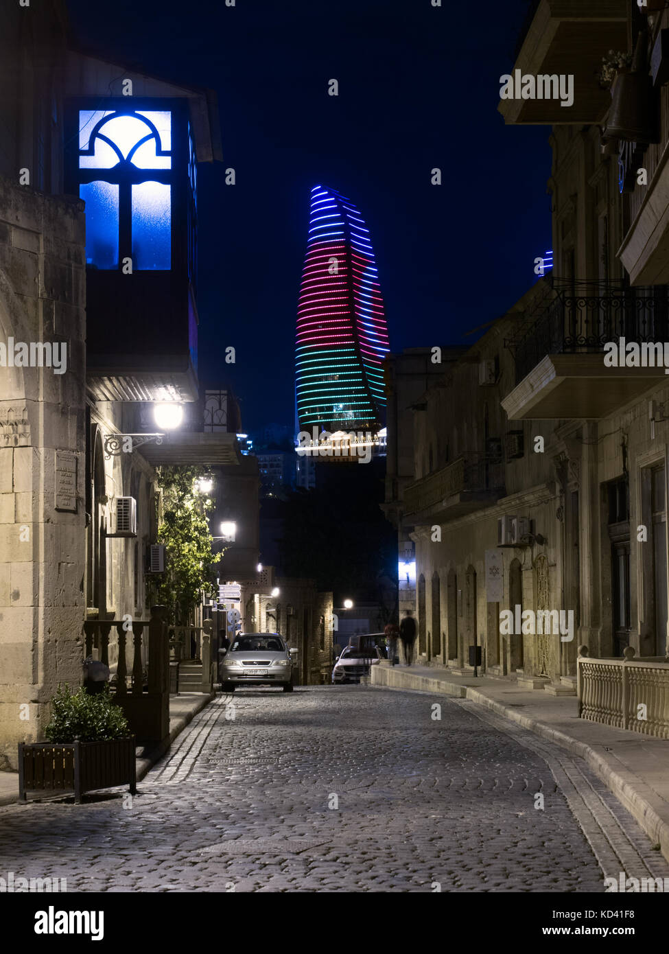Baku, Azerbaijan : Icheri Sheher (Old Town) by night, Flame tower in background - Stock Image