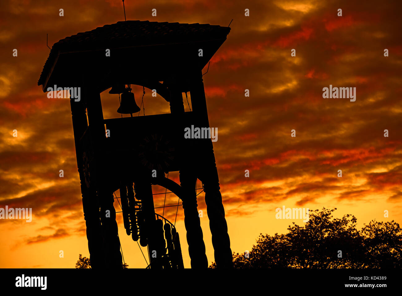 Wooden belltower of the Jesuit Church of the Missions silhouetted against sunset at Concepción, Ñuflo - Stock Image