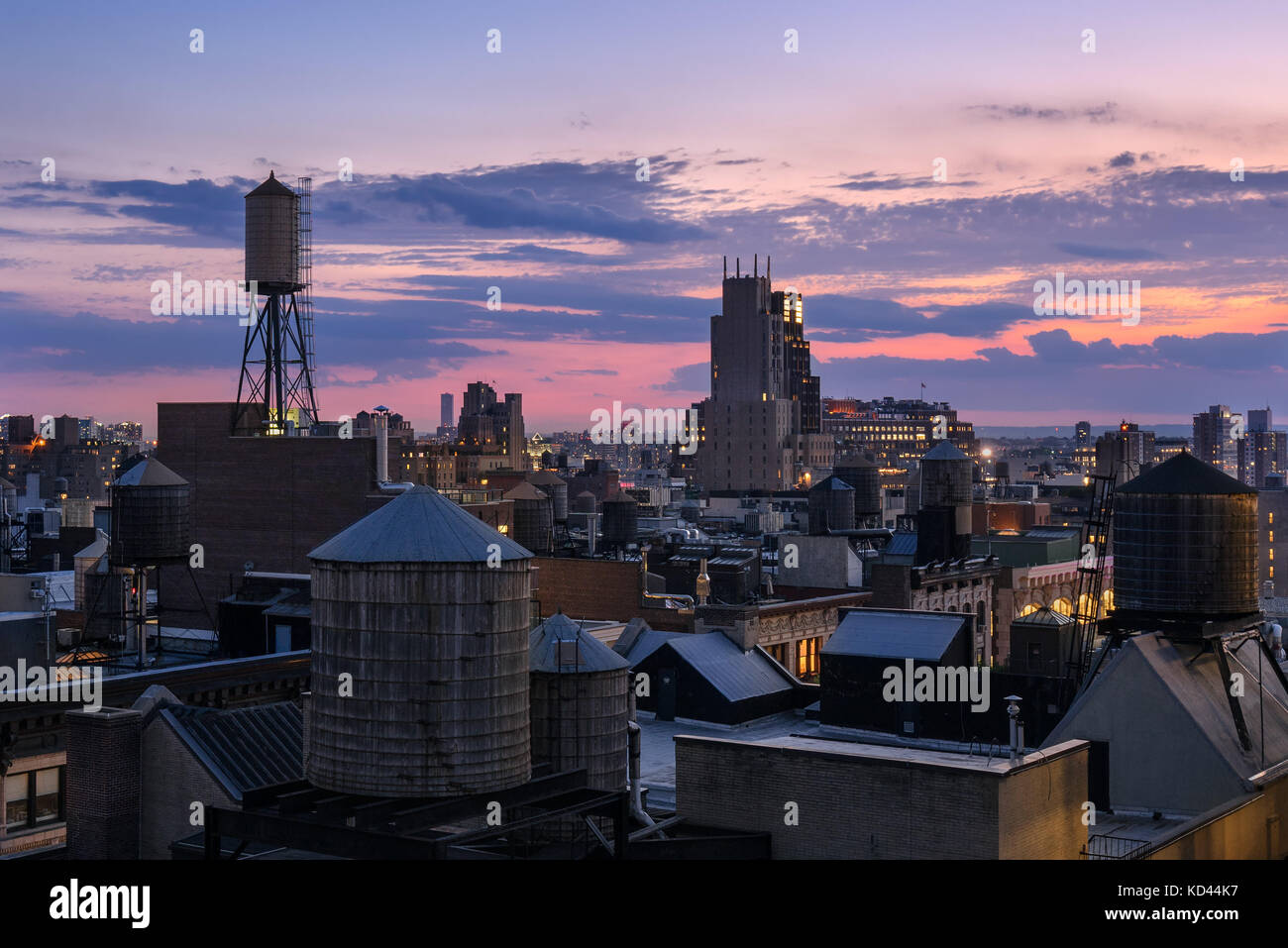 Chelsea rooftops at twilight with water towers and the Walker Tower. Manhattan, New York City - Stock Image