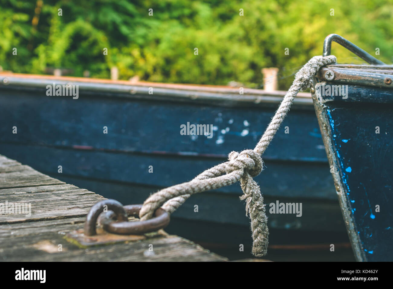 Wooden pleasure rowboat at the pier of a lake for rent. Municipal city park. Hamburg - Stock Image