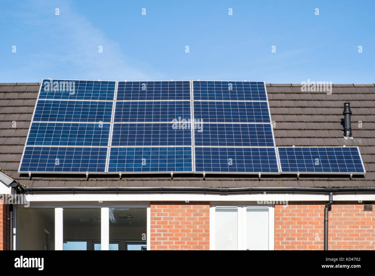 Solar panels on the roof of a house, Nottinghamshire, England, UK - Stock Image