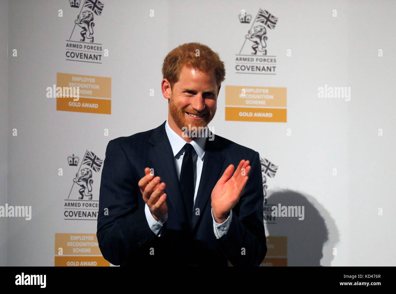 Prince Harry applauds as he presents the Employer Recognition Scheme Gold Awards at the Imperial War Museum in London, - Stock Image