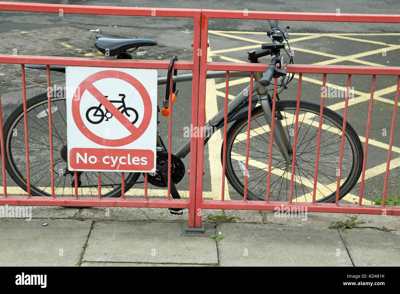 Bike parked behind a 'No Cycles'sign. - Stock Image