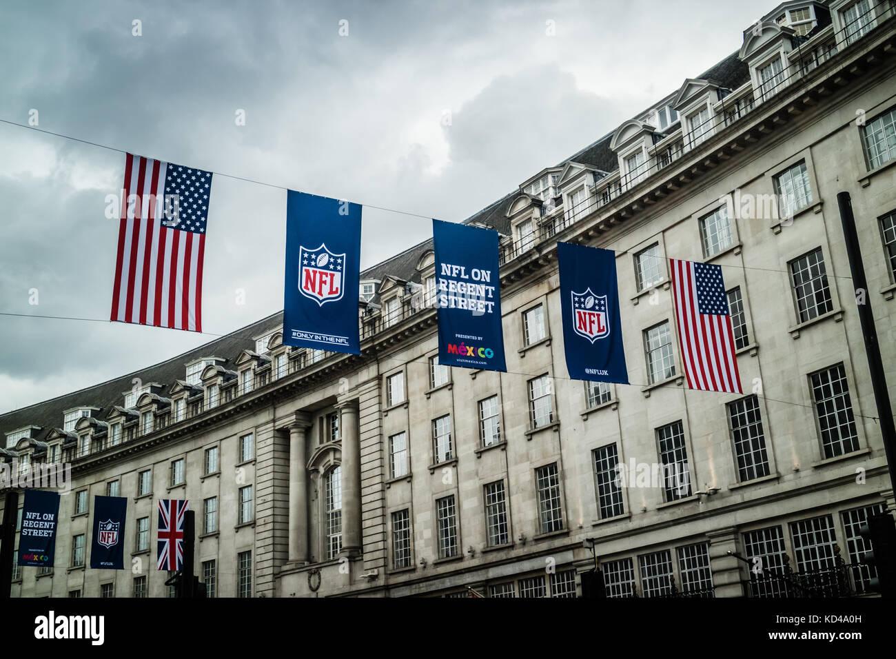 NFL UK event banners and US Flag hanging on Regents Street, London, England, UK - Stock Image