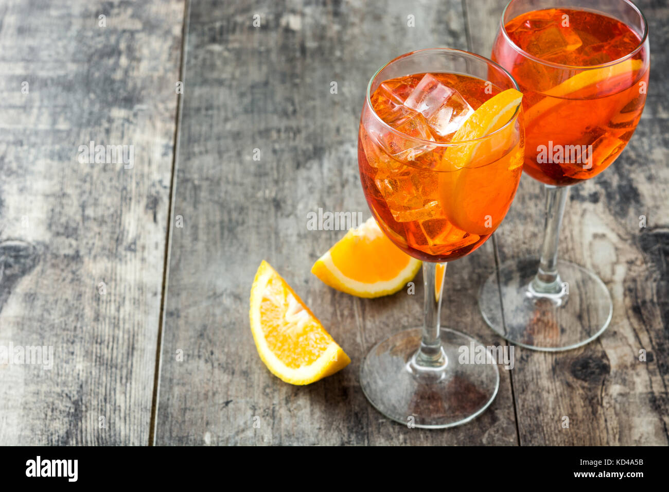 Aperol spritz cocktail in glass on wooden table - Stock Image