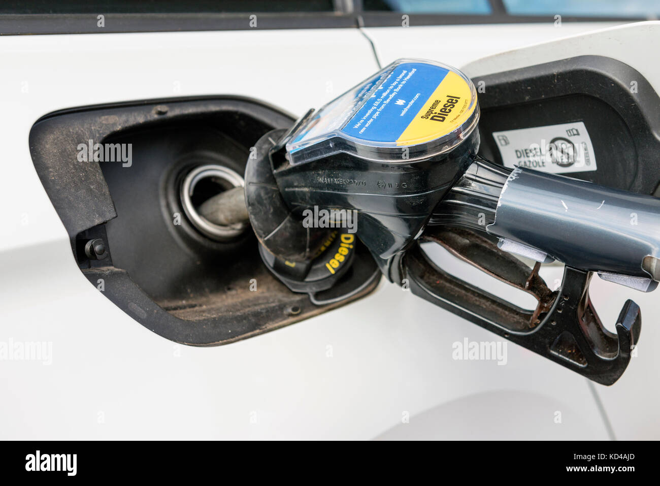 Car filling up with diesel fuel at a pump, UK. - Stock Image