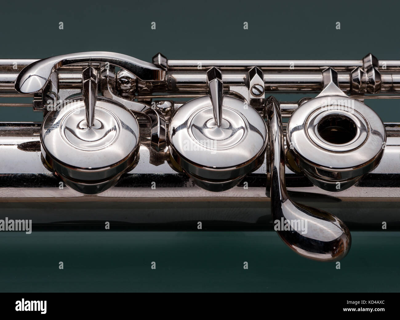 Close-up of keys of a platinum-plated silver flute - Stock Image