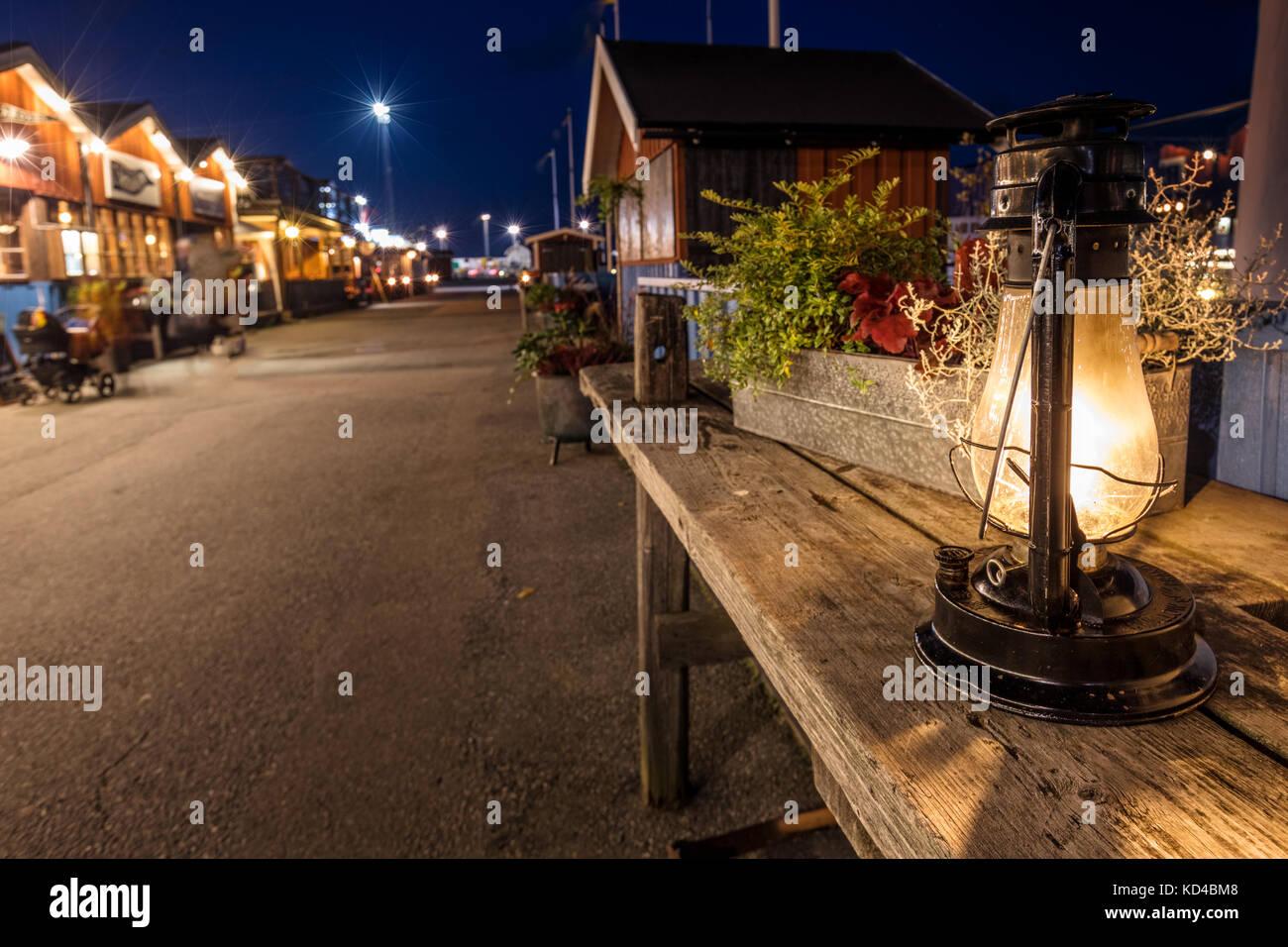 Kerosene old lamp glows at night, Sweden - Stock Image