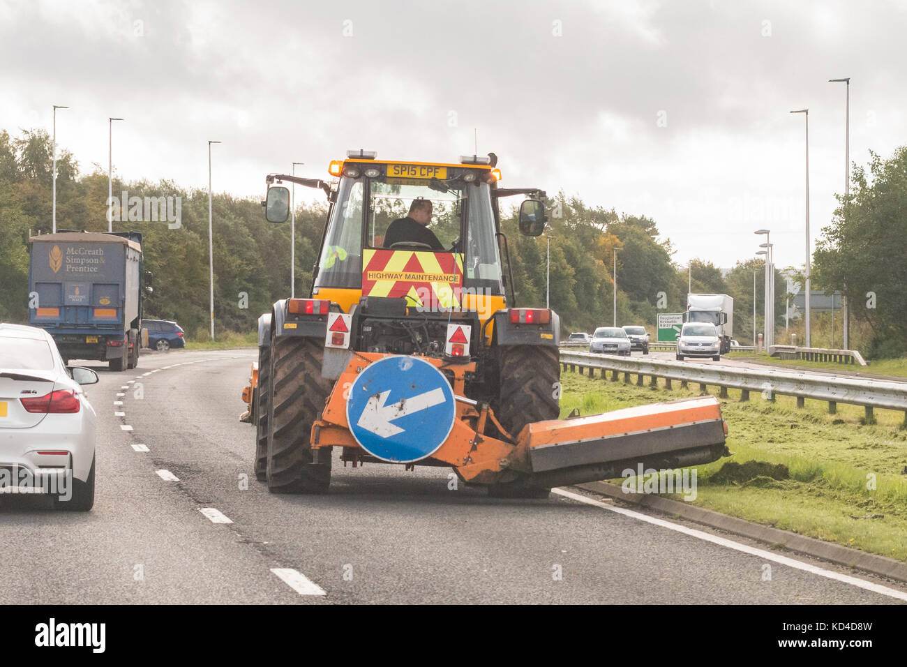 Grass verge cutting on the busy A90 road near Forfar, Scotland, UK - Stock Image