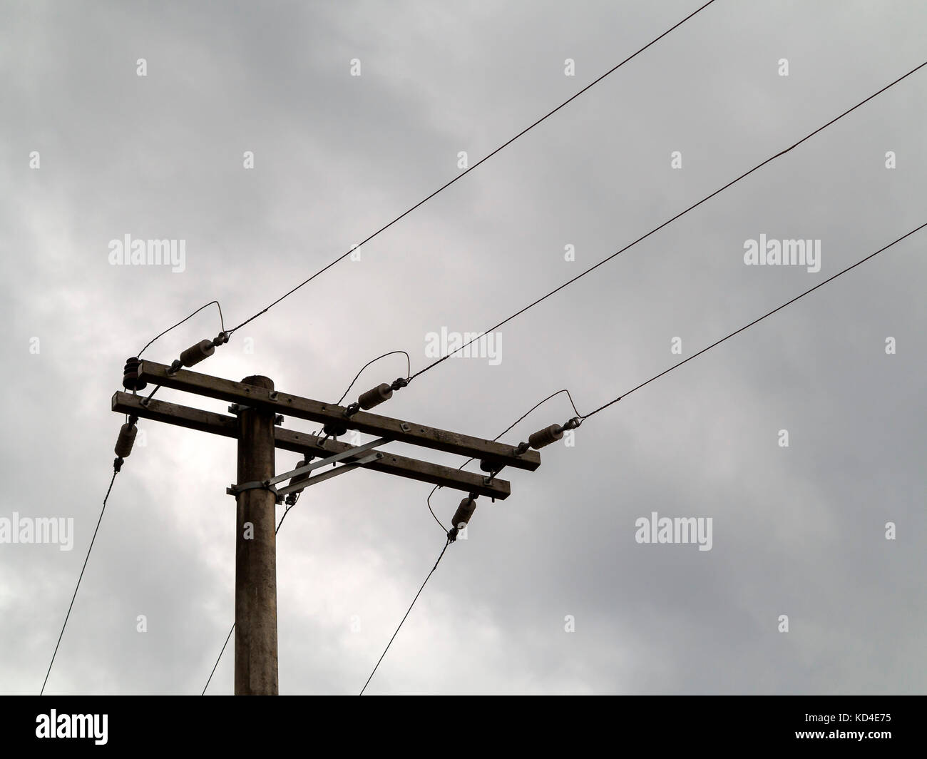 wooden electric post with wires and in a gray cloudy day Stock Photo ...