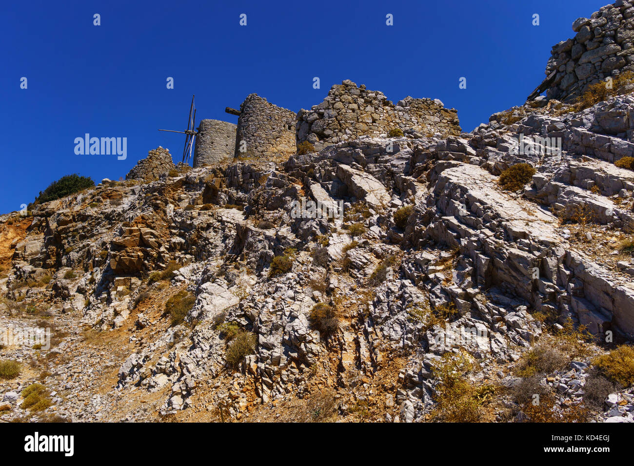 Ruins of encient windmills built in 15th century. Lassithi Plateau, Crete, Greece. Most typical characteristic of - Stock Image