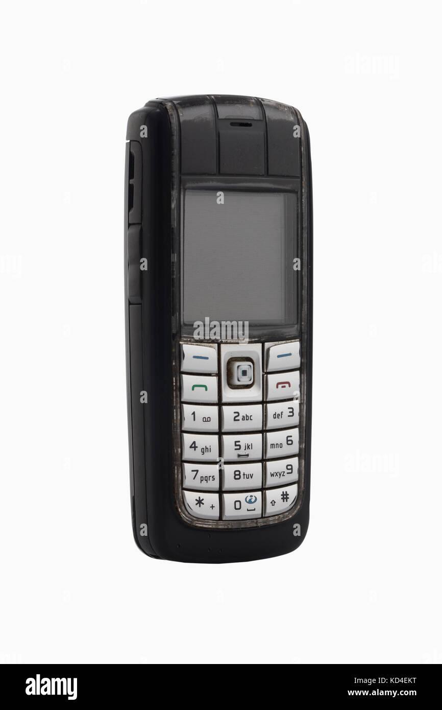 Old-fashioned portable telephone isolated on white - Stock Image