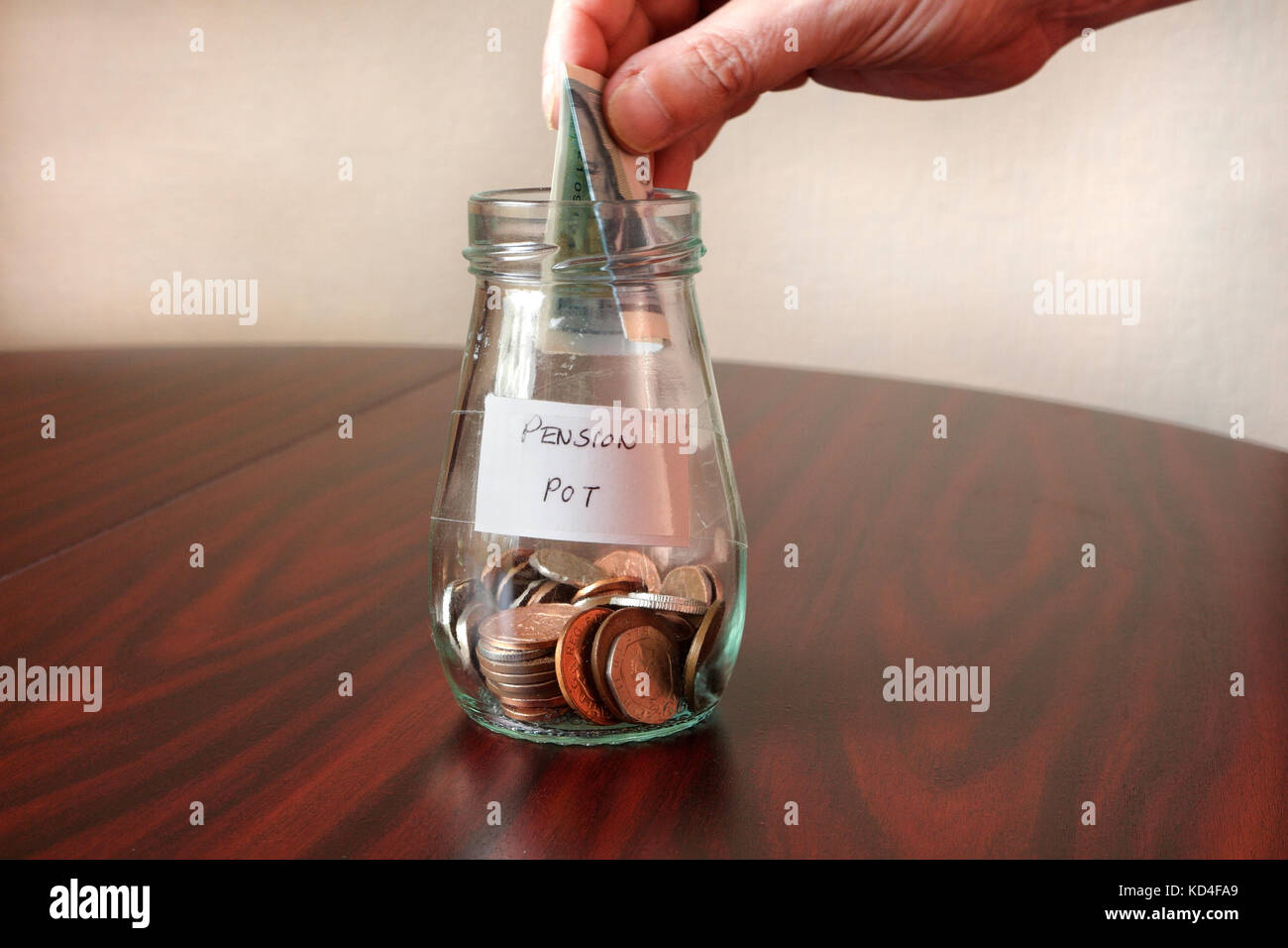 Adding to the Pension Pot - Stock Image