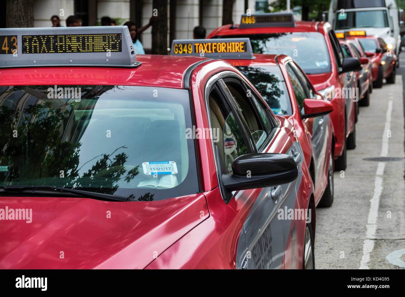 Washington DC District of Columbia Downtown taxicab stand cab taxi cars for hire cabs red - Stock Image