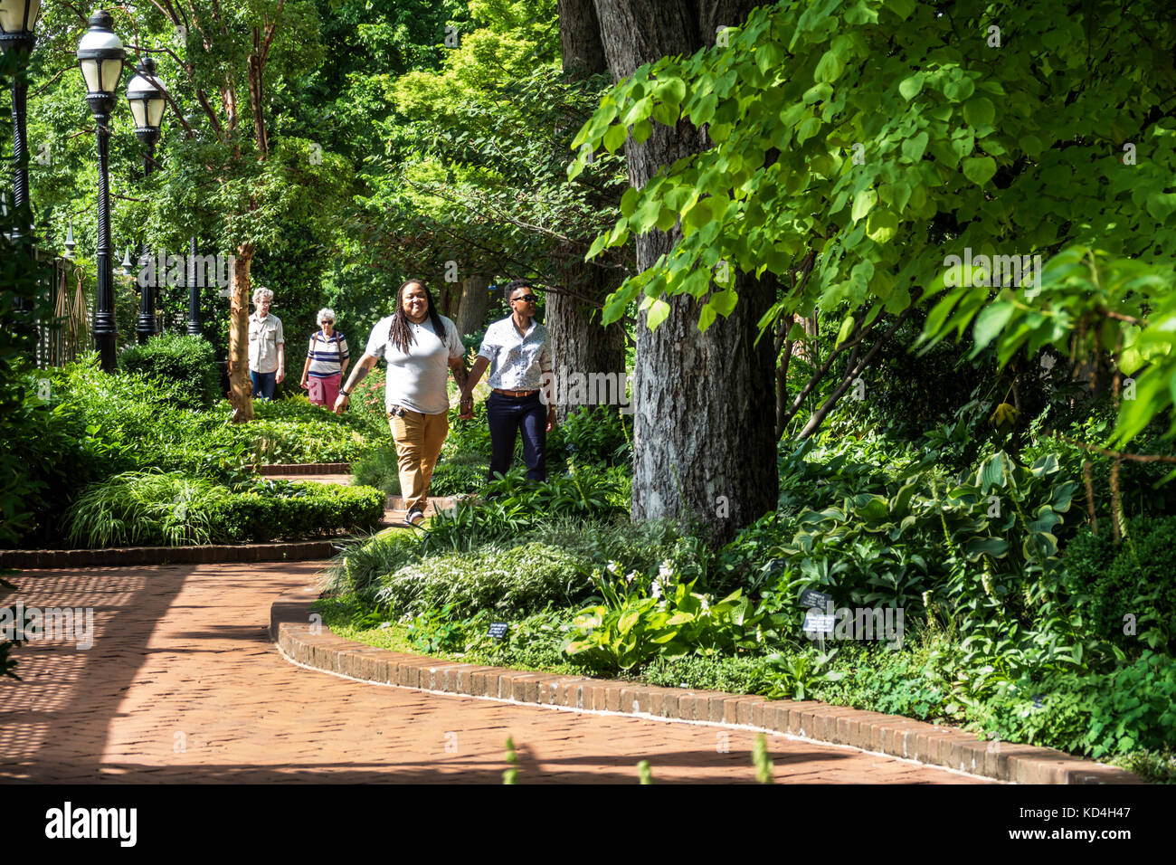 Washington DC District of Columbia National Mall Mary Livingston Ripley Garden horticulture pathway Black man woman - Stock Image