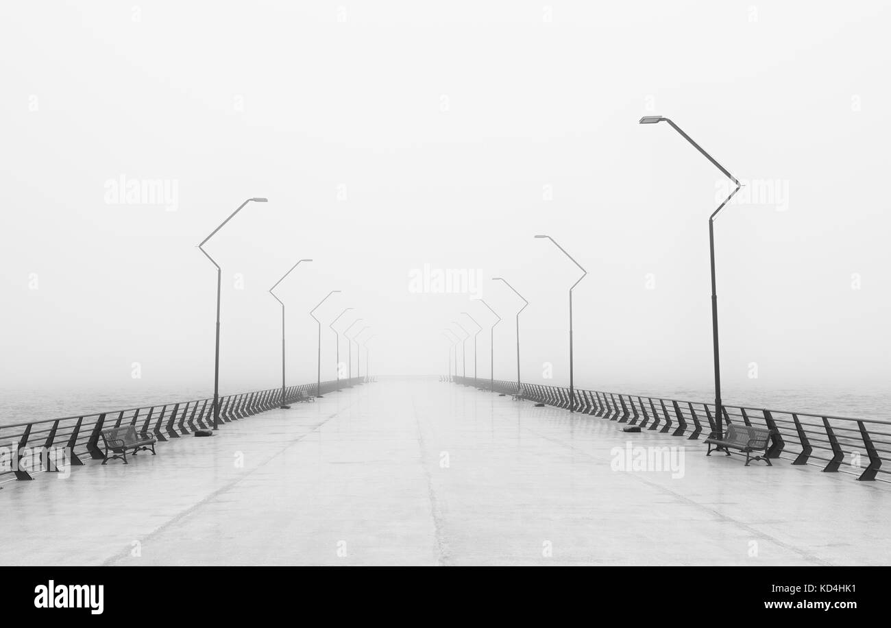 Foggy day on the city embankment - Stock Image