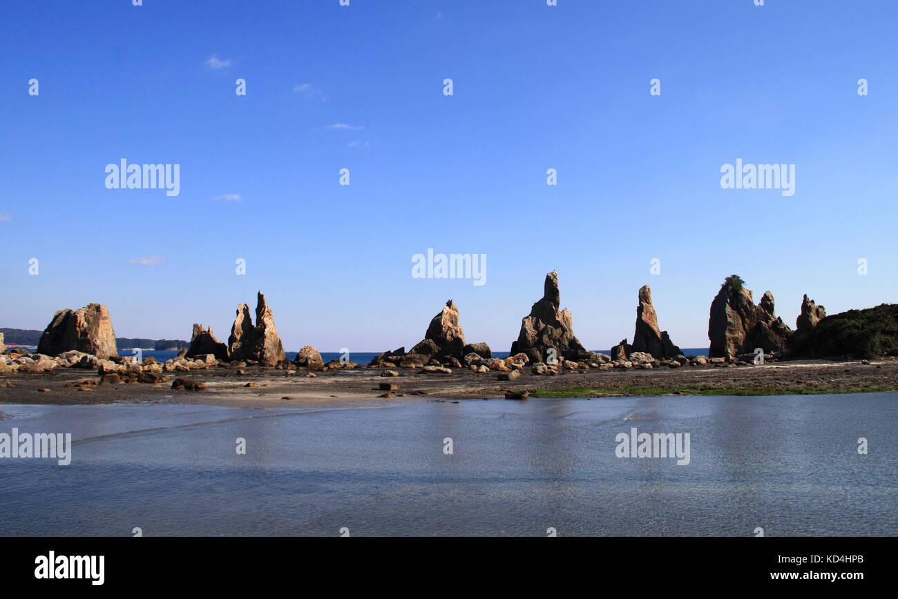 Hashigui-iwa or bridge pillar rocks were created by the famous monk Kobo Daishi. A series of rocks dot the coastline - Stock Image