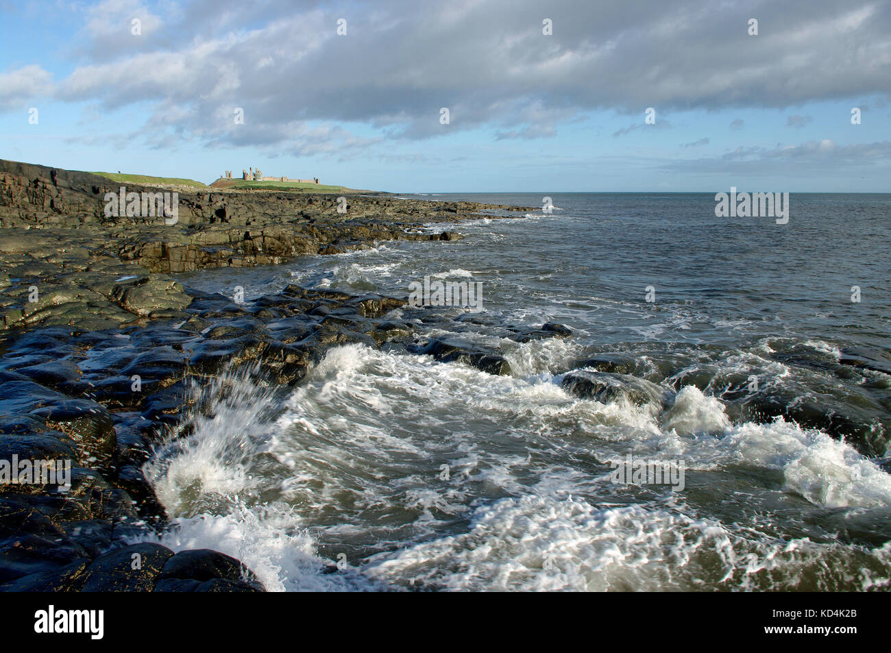 Dunstanburgh Castle and coast - Stock Image